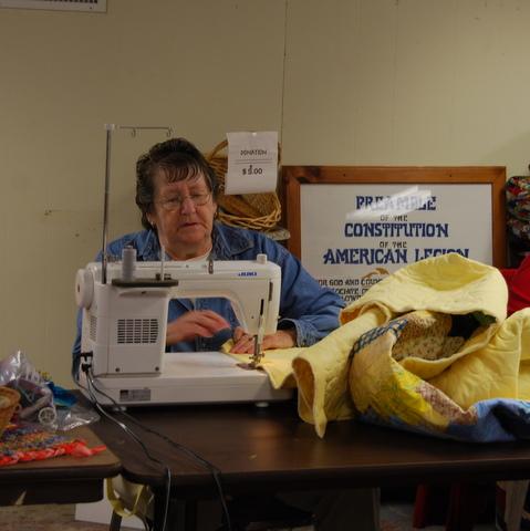 Rebecca binding a quilt